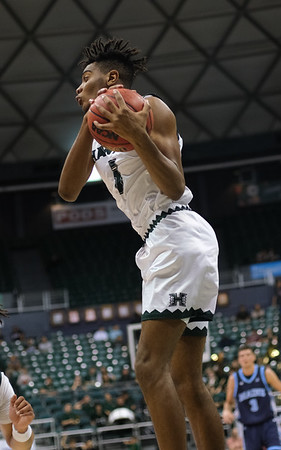 Hawaii forward Bernardo Da Silva comes down with the rebound against Maine at the Stan Sheriff Center, Honolulu, Hawaii on December 29, 2019.