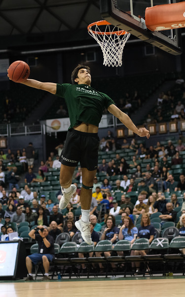 Hawaii volleyball player Cole Hogland dunks during halftime of the Hawaii-Maine basketball game at the Stan Sheriff Center, Honolulu, Hawaii on December 29, 2019.