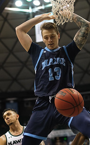 Maine forward Miks Antoms dunks against Hawaii at the Stan Sheriff Center, Honolulu, Hawaii on December 29, 2019.