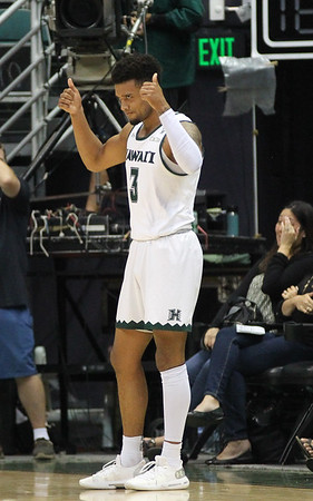 Hawaii guard Eddie Stansberry gives two thumbs up against Maine at the Stan Sheriff Center, Honolulu, Hawaii on December 29, 2019.