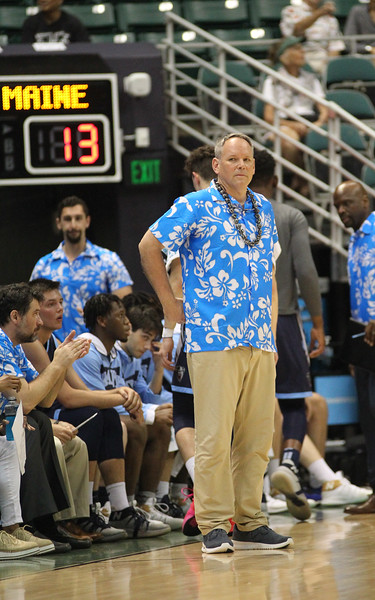 Maine head coach Richard Baron observes the action against Hawaii at the Stan Sheriff Center, Honolulu, Hawaii on December 29, 2019.