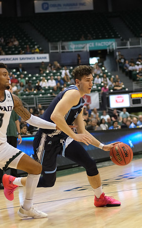 Maine's Mykhailo Yagodin drives against Hawaii's Eddie Stansberry at the Stan Sheriff Center, Honolulu, Hawaii on December 29, 2019.
