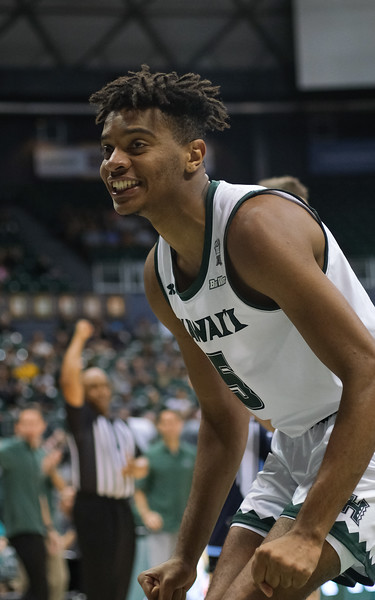 Hawaii's Bernardo Da Silva smiles after drawing a foul against Maine at the Stan Sheriff Center, Honolulu, Hawaii on December 29, 2019.