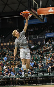 Hawaii volleyball libero Gage Worsley attempts a dunk during halftime of the Hawaii-Maine basketball game at the Stan Sheriff Center, Honolulu, Hawaii on December 29, 2019.