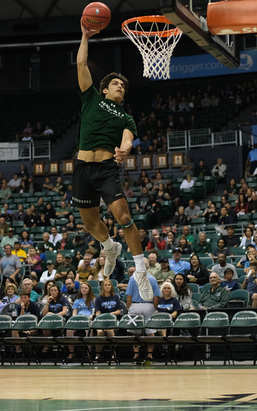 Hawaii volleyball player Cole Hogland attempts a dunk during halftime of the Hawaii-Maine basketball game at the Stan Sheriff Center, Honolulu, Hawaii on December 29, 2019.