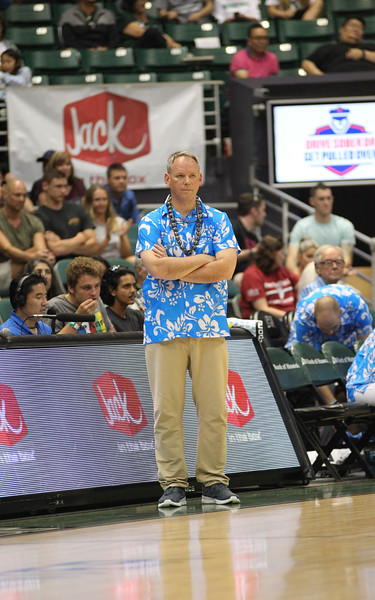 Maine head coach Richard Barron observes the action against Hawaii at the Stan Sheriff Center, Honolulu, Hawaii on December 29, 2019.