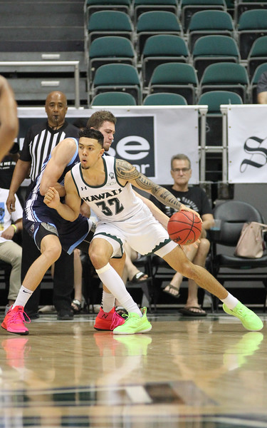 Hawaii forward Samuta Avea posts up Maine's Nedeljko Prijovic at the Stan Sheriff Center, Honolulu, Hawaii on December 29, 2019.