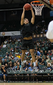 Hawaii volleyball player Colton Cowell attempts a dunk during halftime of the Hawaii-Maine basketball game at the Stan Sheriff Center, Honolulu, Hawaii on December 29, 2019.