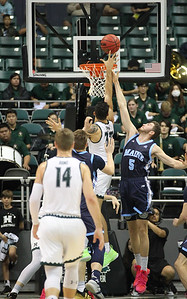 Hawaii's Samuta Avea shoots over Maine's Nedeljko Prijovic at the Stan Sheriff Center, Honolulu, Hawaii on December 29, 2019.