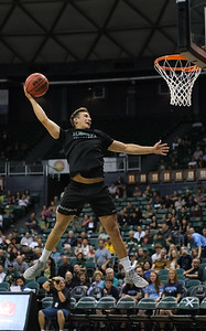 Hawaii volleyball outside hitter Colton Cowell attempts a dunk during halftime of the Hawaii-Maine basketball game at the Stan Sheriff Center, Honolulu, Hawaii on December 29, 2019.