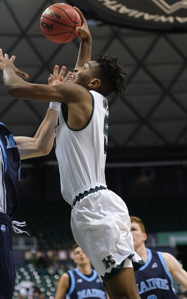 Hawaii's Bernardo Da Silva rises up for a dunk attempt against Maine at the Stan Sheriff Center, Honolulu, Hawaii on December 29, 2019.