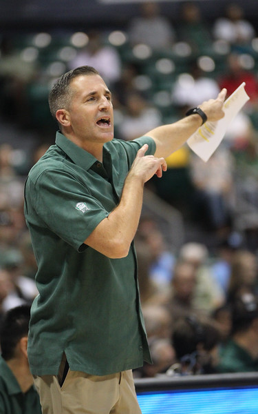 Hawaii assistant coach Chris Gerlufsen, who served as the team's acting head coach for the past 13 games, directs his players against Maine at the Stan Sheriff Center, Honolulu, Hawaii on December 29, 2019.