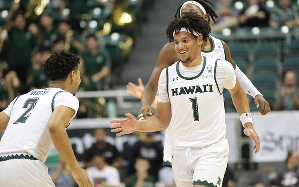 Hawaii guard Drew Buggs smiles after hitting a buzzer-beating shot to end the first half against Maine at the Stan Sheriff Center, Honolulu, Hawaii on December 29, 2019. The shot was later waved off.