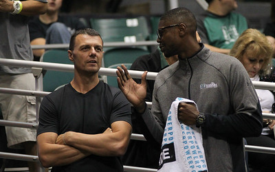 Honorary Captain Nerijus Puida speaks with former Rainbow Warrior Mike Thomas before Hawaii's game against Maine at the Stan Sheriff Center, Honolulu, Hawaii on December 29, 2019.