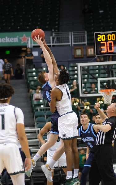 Hawaii's Bernardo Da Silva jumps for the tip against Maine at the Stan Sheriff Center, Honolulu, Hawaii on December 29, 2019.