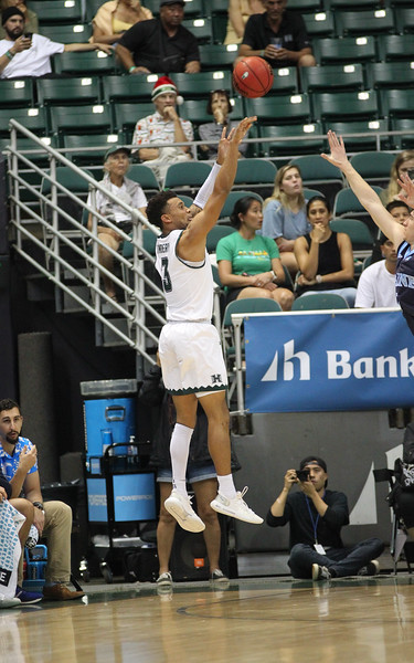 Hawaii's Eddie Stansberry shoots a three from the wing against Maine at the Stan Sheriff Center, Honolulu, Hawaii on December 29, 2019.