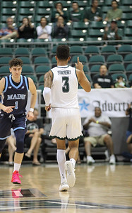 Hawaii guard Eddie Stansberry celebrates after hitting a three pointer in the first half against Maine at the Stan Sheriff Center, Honolulu, Hawaii on December 29, 2019.