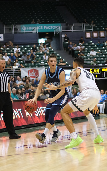 Maine forward Vilgot Larsson dribbles as Hawaii forward Samuta Avea defends at the Stan Sheriff Center, Honolulu, Hawaii on December 29, 2019.