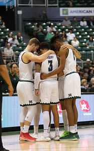 Hawaii starters huddle up before the game against Maine at the Stan Sheriff Center, Honolulu, Hawaii on December 29, 2019.