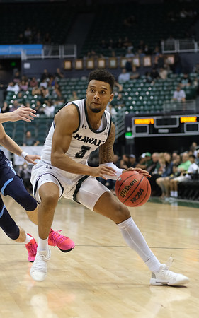 Hawaii's Eddie Stansberry drives to the basket against Maine at the Stan Sheriff Center, Honolulu, Hawaii on December 29, 2019.