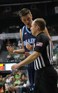 Maine's Vilgot Larsson asks the referee for a foul call against Hawaii at the Stan Sheriff Center, Honolulu, Hawaii on December 29, 2019.