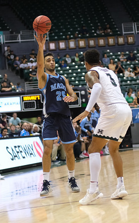 Maine guard Sergio El Darwich feeds the post against Hawaii at the Stan Sheriff Center, Honolulu, Hawaii on December 29, 2019.