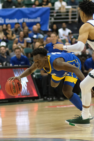UCSB guard Devearl Ramsey (4) stumbles during a drive against Hawaii at the Stan Sheriff Center, Honolulu, Hawaii on January 18, 2020. Ramsey had 6 points for the Gauchos.