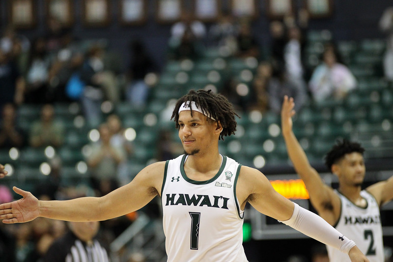 Drew Buggs extends for a handshake from a teammate at the Stan Sheriff Center, Honolulu, Hawaii on January 18, 2020.