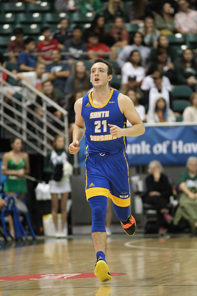 Max Heidegger of UCSB trots down the court at the Stan Sheriff Center, Honolulu, Hawaii on January 18, 2020. Heidegger came off the bench to lead the Gauchos with 21 points.