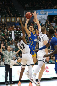 UCSB's Jaquori McLaughlin attempts a buzzer beater at the half against Hawaii at the Stan Sheriff Center, Honolulu, Hawaii on January 18, 2020. UCSB led Hawaii at the half, 35-33.