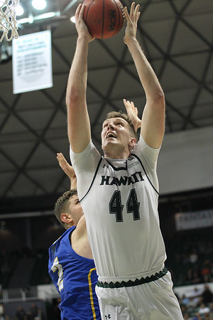 Dawson Carper puts back a miss at the Stan Sheriff Center, Honolulu, Hawaii on January 18, 2020. Carper had 7 boards to lead the 'Bows.