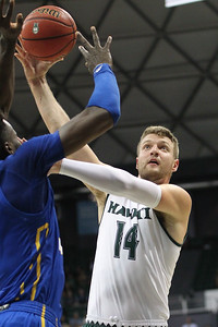 Zigmars Raimo shoots a running jump hook against UCSB at the Stan Sheriff Center, Honolulu, Hawaii on January 18, 2020. Raimo was 4-9 from the field.