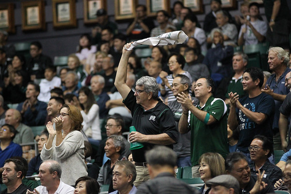 A Hawaii fan waves the towel at the Stan Sheriff Center, Honolulu, Hawaii on January 18, 2020. Fans received free tacos as the 'Bows scored more than 62 points.