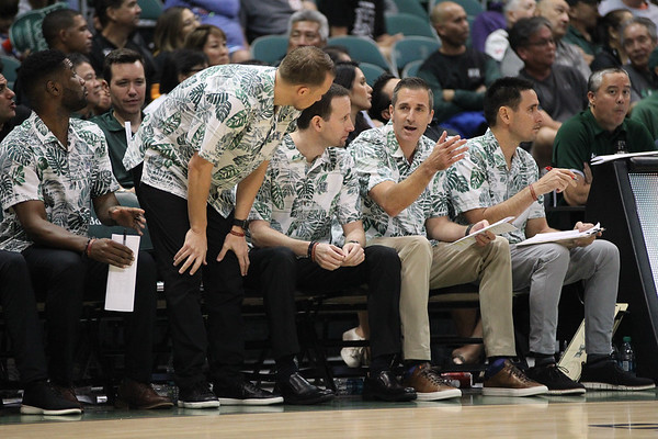 Hawaii coaches discuss matters during a game against UCSB at the Stan Sheriff Center, Honolulu, Hawaii on January 18, 2020. Hawaii won, 70-63.
