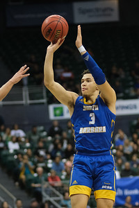UCSB's Jaquori McLaughlin shoots a jumper against Hawaii at the Stan Sheriff Center, Honolulu, Hawaii on January 18, 2020. McLaughlin dropped in 14 points for the Gauchos.