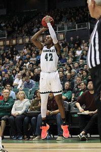 Justin Hemsley shoots a 3 from the corner against UCSB at the Stan Sheriff Center, Honolulu, Hawaii on January 18, 2020. Hemsley made 1 of 2 from behind the line and finished with 6 points.