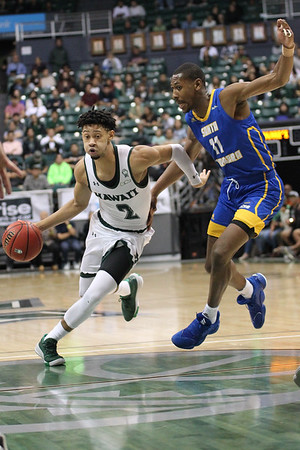 Justin Webster (2) of Hawaii drives on Brandon Cyrus (11) of USCB at the Stan Sheriff Center, Honolulu, Hawaii on January 18, 2020. Webster came off the bench to to chip in 11 points for the 'Bows.
