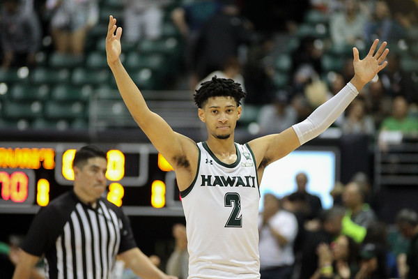 Justin Webster raises his arms after his Rainbow Warriors beat the UCSB Gauchos, 70-63, at the Stan Sheriff Center, Honolulu, Hawaii on January 18, 2020.