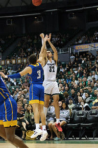 Hawaii's Samuta Avea (32) shoots over UCSB's Jaquori McLaughlin (3) at the Stan Sheriff Center, Honolulu, Hawaii on January 18, 2020. Avea played just 10 minutes and scored 5 points.