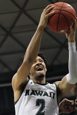 Justin Webster attacks the rim against UCSB at the Stan Sheriff Center, Honolulu, Hawaii on January 18, 2020. Hawaii won, 70-63.