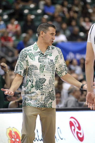 Hawaii assistant coach Chris Gerlufsen shrugs his shoulders during a game against UCSB at the Stan Sheriff Center, Honolulu, Hawaii on January 18, 2020. Hawaii won, 70-63.