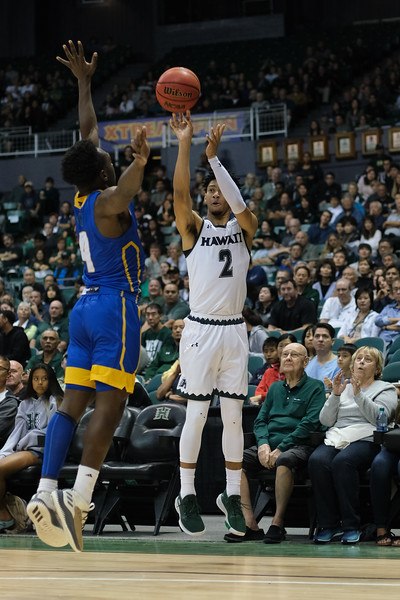 Justin Webster (2) of Hawaii shoots over Devearl Ramsey (4) of UCSB at the Stan Sheriff Center, Honolulu, Hawaii on January 18, 2020. Webster was 2-5 from three point land.