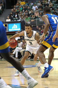 Hawaii's Eddie Stansberry looks to drive against UCSB at the Stan Sheriff Center, Honolulu, Hawaii on January 18, 2020. Stansberry played all 40 minutes for Hawaii.