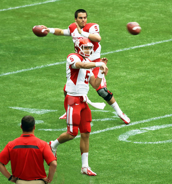 Quarterbacks O'Korn (foreground) and backup Cosh warming up.