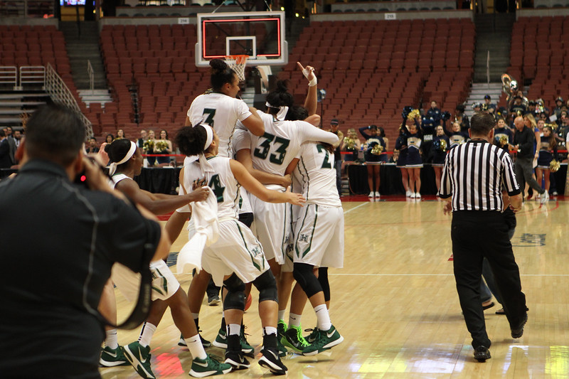 The UH Wahine basketball team celebrates as time expires after beating UC Davis, 78-59, in the championship of the 2016 Big West Tournament at the Honda Center, Anaheim, CA on March 12, 2016.