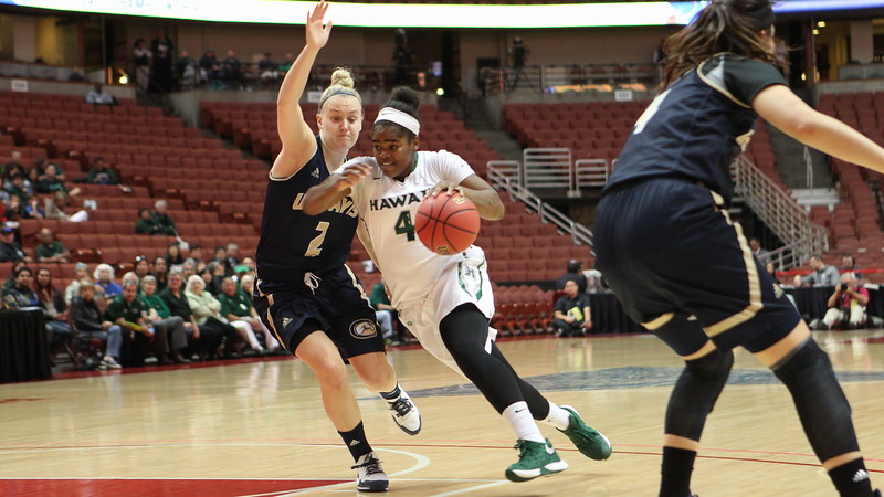 Hawaii guard Briana Harris (4) drives on Davis guard Kourtney Eaton (2) in the championship game of the 2016 Big West Tournament at the Honda Center, Anaheim, CA on March 12, 2016.