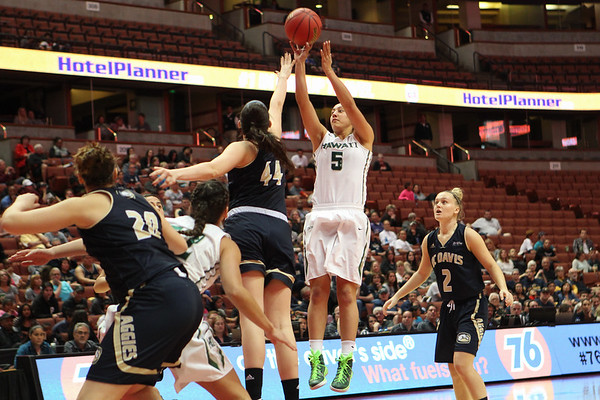 Hawaii guard Sarah Toeaina (5) shoots over the outstretched hand of Davis forward Alyson Doherty in the championship game of the 2016 Big West Tournament at the Honda Center, Anaheim, CA on March 12, 2016.