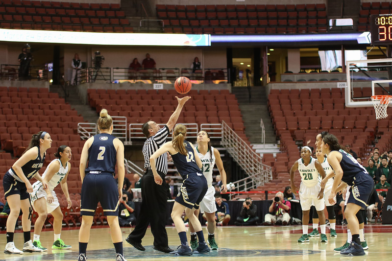 Hawaii center Kalei Adolpho (32) and Davis forward Morgan Bertsch (22) tip off in the championship of the 2016 Big West Tournament at the Honda Center, Anaheim, CA on March 12, 2016.