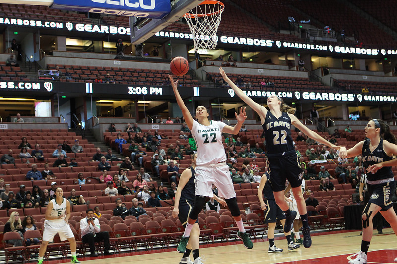 Hawaii's Ashleigh Karaitiana lays it in as Davis' Morgan Bertsch defends in the championship of the 2016 Big West Tournament at the Honda Center, Anaheim, CA on March 12, 2016.
