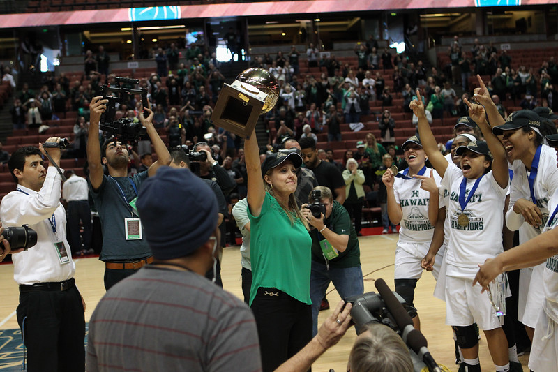 Hawaii head coach Laura Beeman raises the Big West Championship trophy after beating UC Davis, 78-59, in the title game of the 2016 Big West Tournament at the Honda Center, Anaheim, CA on March 12, 2016.